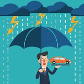 Business man standing with umbrella under thunderstorm protecting car