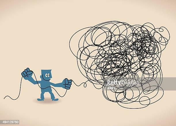 Business Mann untangle ein Verheddert Unordentlich Knoten (grüne Linie).