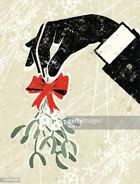 business man's hand holding a sprig of mistletoe - mistletoe stock illustrations, clip art, cartoons, & icons