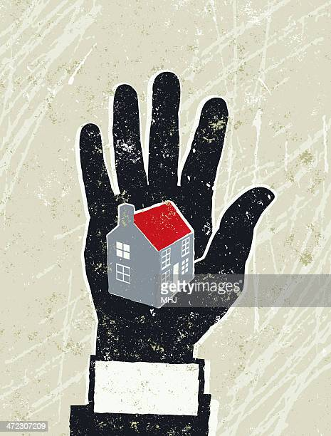 business man's hand with a house on the palm - subprime loan crisis stock illustrations