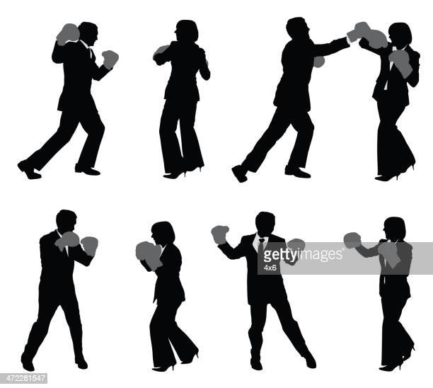 Business people fighting and boxing
