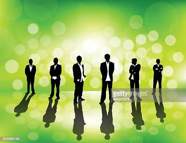 Gente de negocios sobre fondo verde desenfoque de
