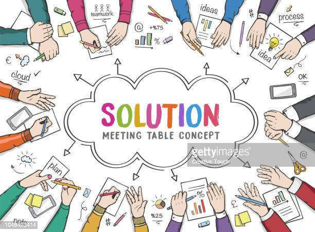 Business people on meeting table