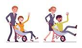 Business people pushing men in the wheelbarrow