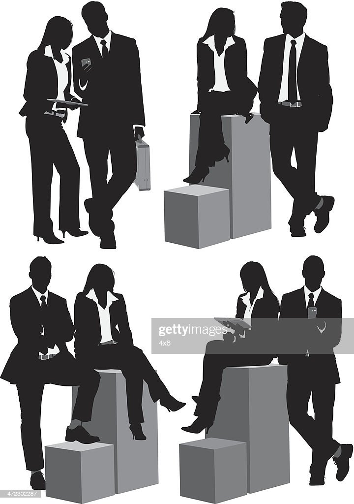 Business people sitting on box