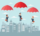 Business people with parachute over city
