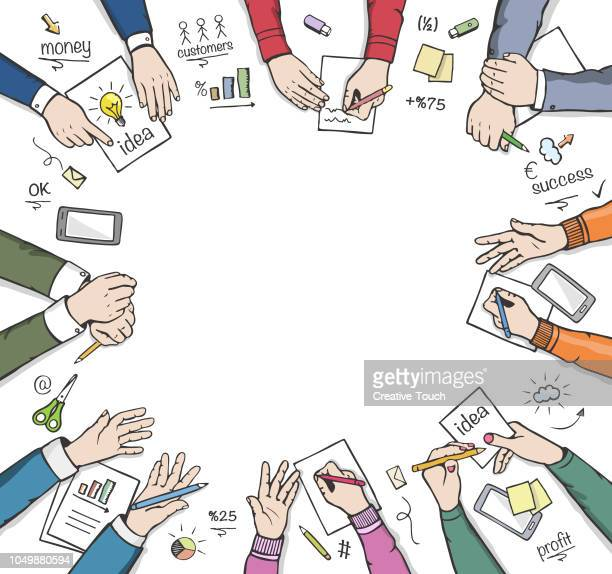 Business peoples and meeting table