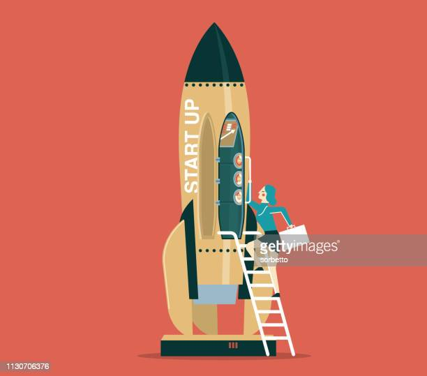 Business startup with space rocket - Businesswoman