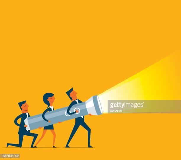 business team holding a big flashlight - flashlight stock illustrations