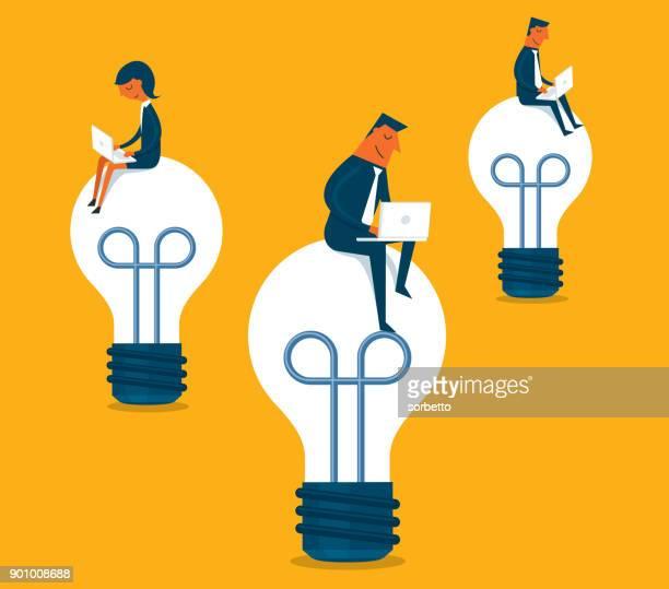 Business team sitting on light bulb