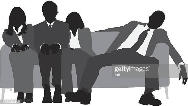 Business team sitting on sofa