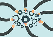 Business teamwork concept. People hands holding cog wheels