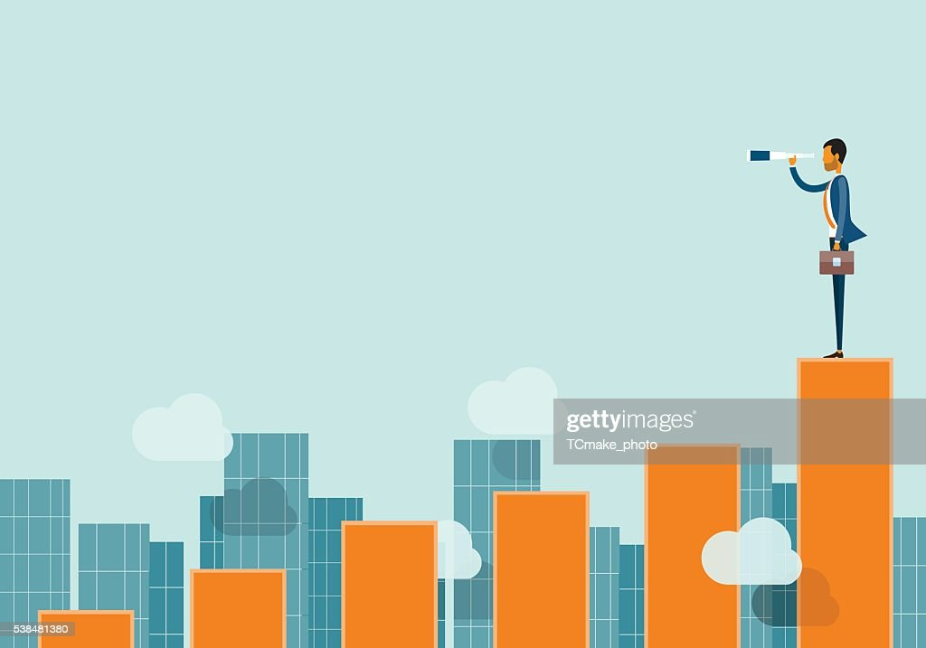 business vision concept and business man standing on graph