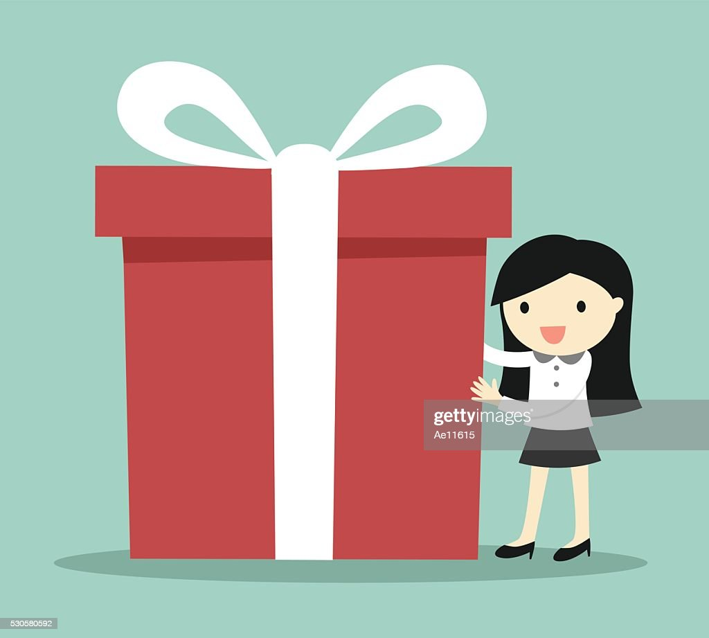 Business woman holding a big gift box for Christmas festival.