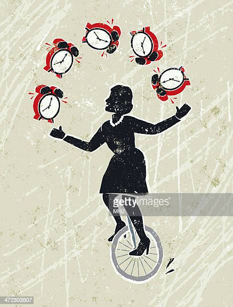 Business Woman Juggling Alarm Clocks Whilst Riding a Unicycle