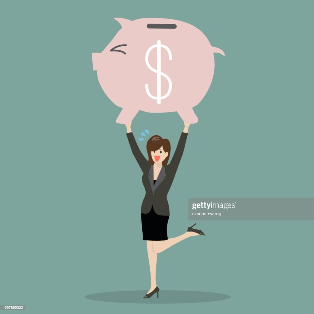 Business woman lifting a piggy bank