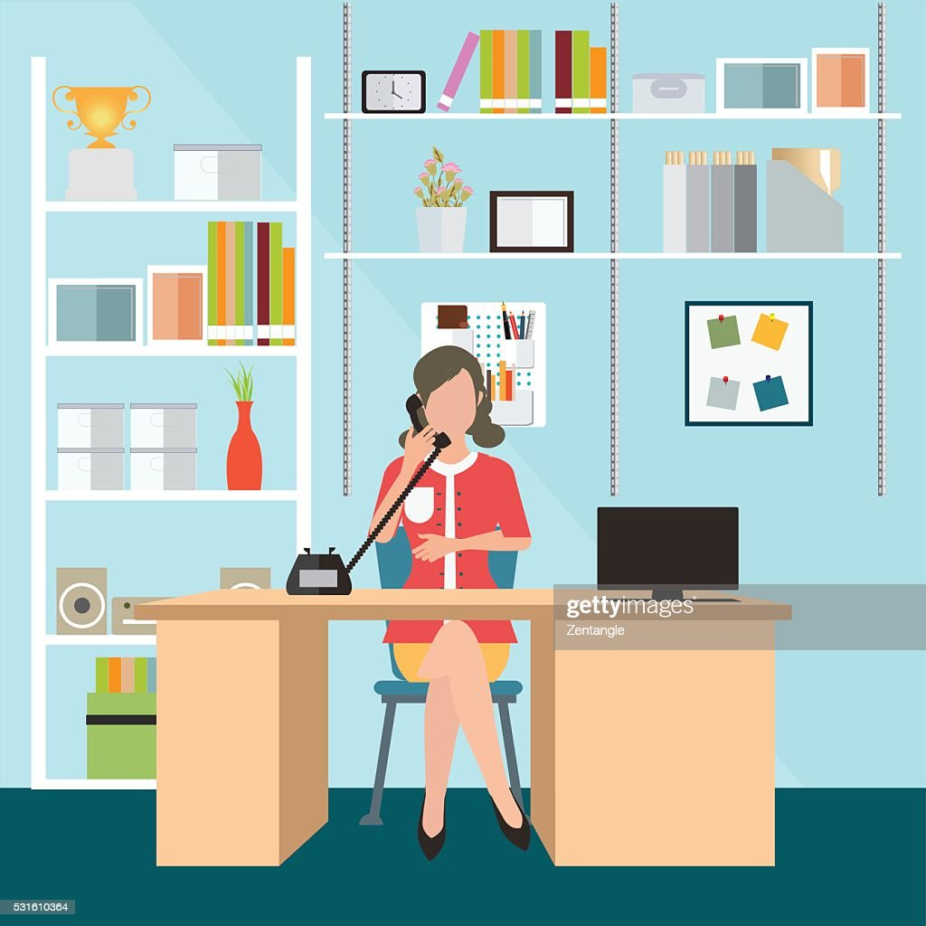 Business woman talking on the phone in office.