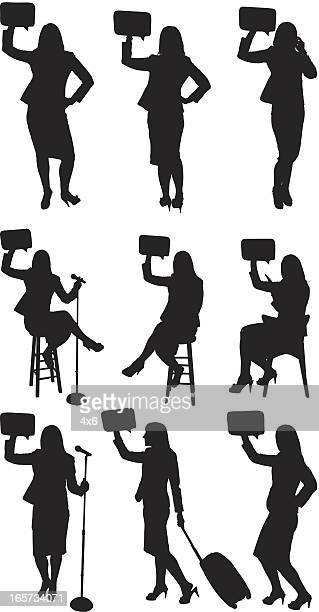 business women holding speech bubbles - black shoe stock illustrations