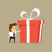 businessman and a big gift box