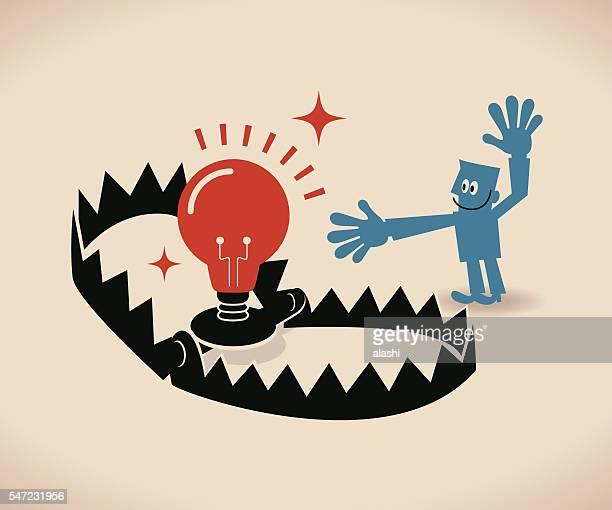 Businessman and bear trap with business ideas (bulb) as bait