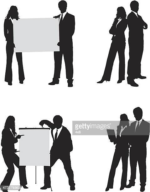 businessman and businesswoman holding up signboard - back to back stock illustrations, clip art, cartoons, & icons