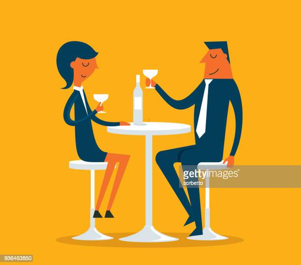 Businessman and Businesswoman in pub