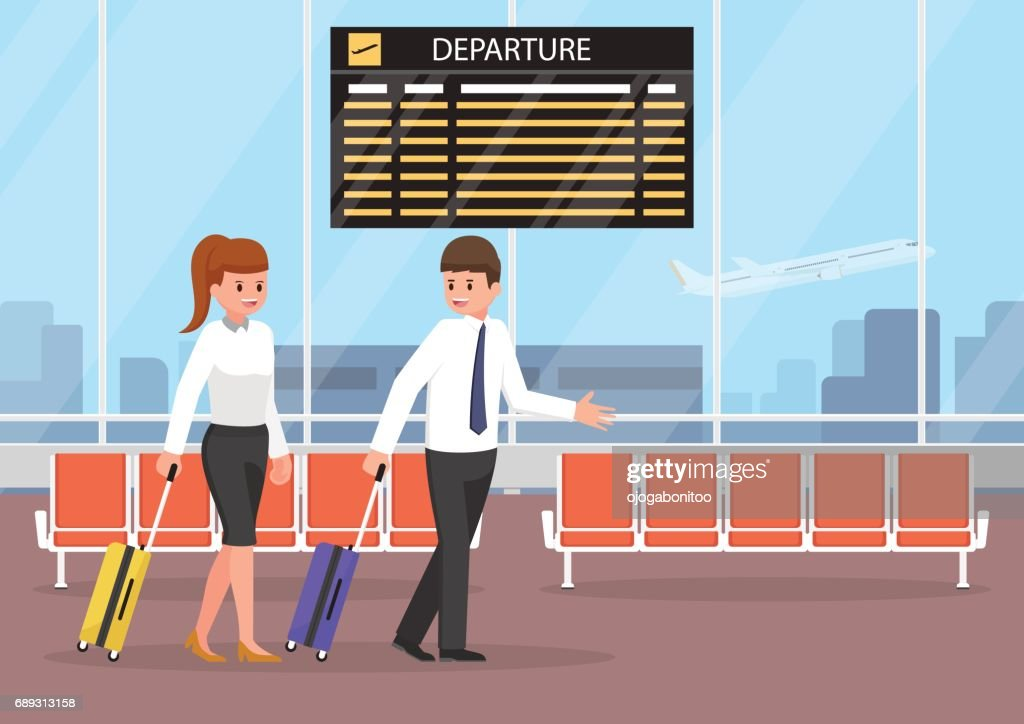 Businessman and businesswoman with luggage at the airport terminal.