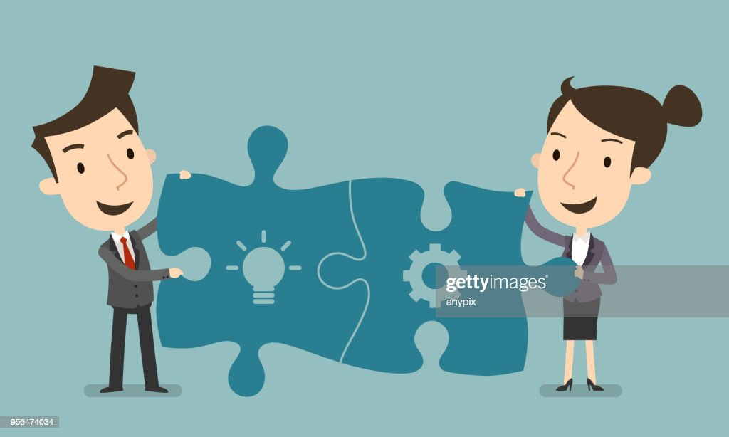 Businessman and woman connecting puzzle elements