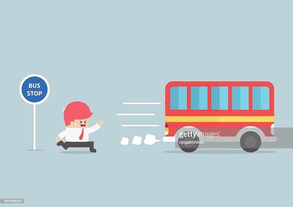 Businessman arriving too late at bus stop