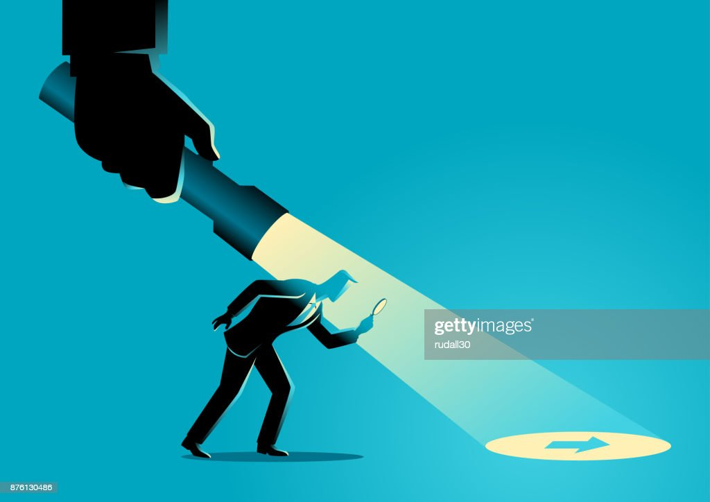 Businessman being guided by a hand holding a flashlight