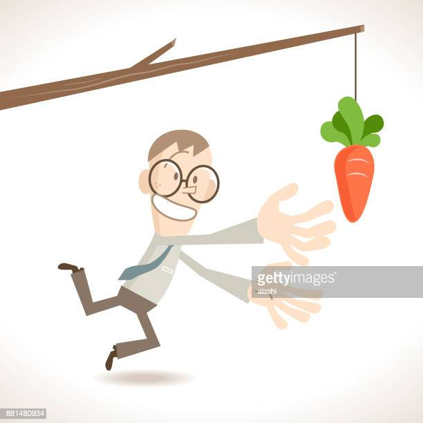 Businessman being tempted and reaching for a carrot at the end of a stick