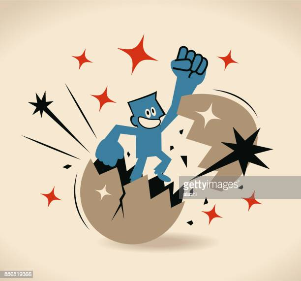 businessman breaking and jumping out of a giant egg shell with fist punching the air - animal egg stock illustrations, clip art, cartoons, & icons