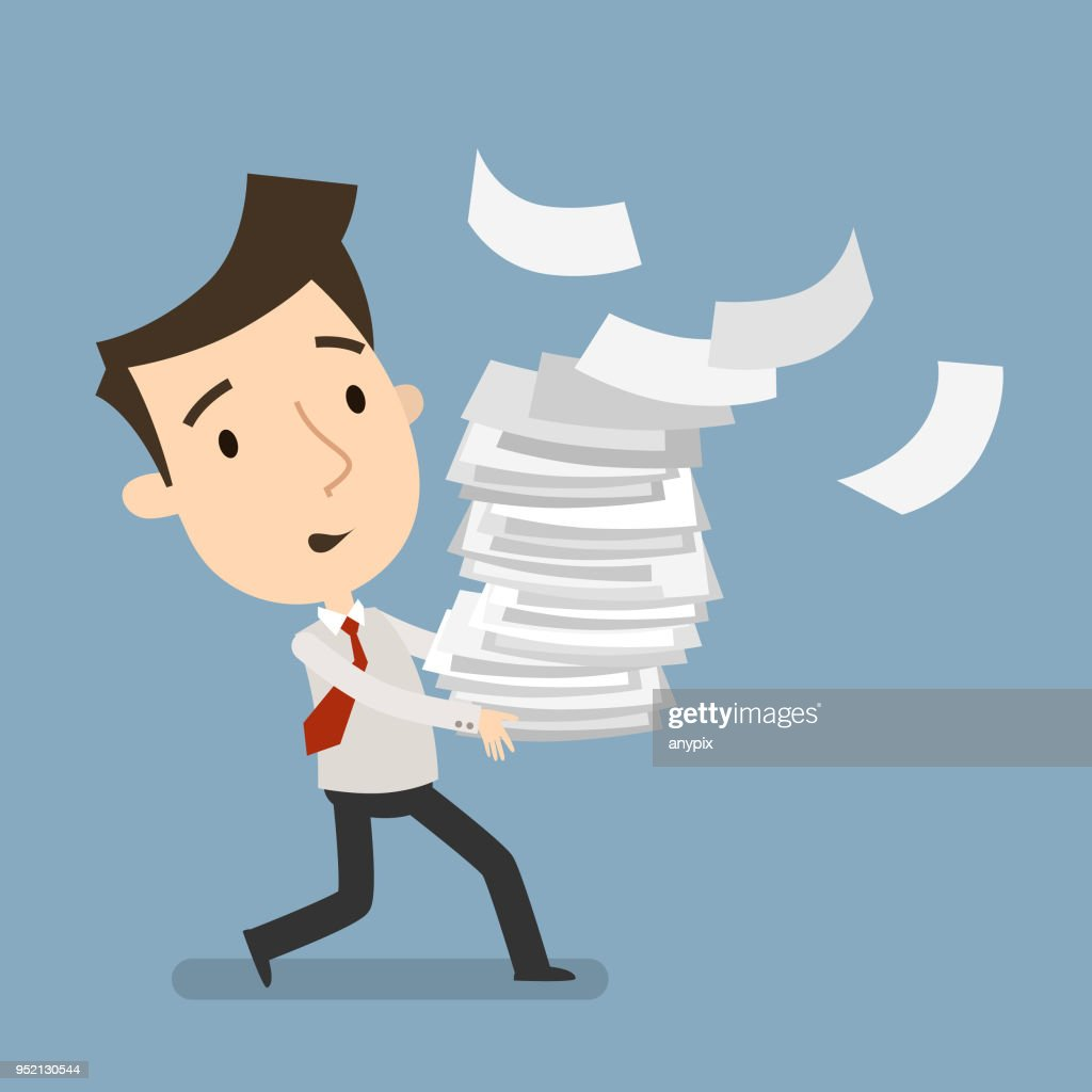 Businessman carries a large bundle of paper
