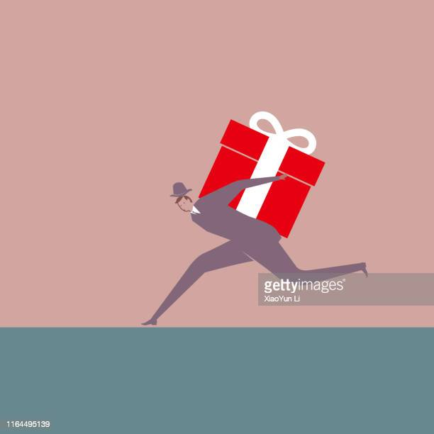 businessman carrying a gift - goodie bag stock illustrations, clip art, cartoons, & icons