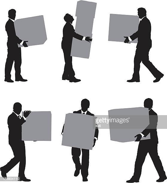 Businessman carrying cardboard boxes