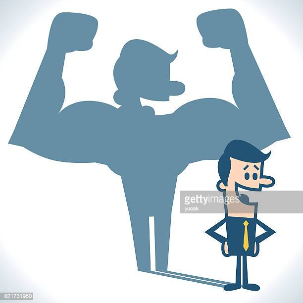 businessman casting strong man shadow - vanity stock illustrations