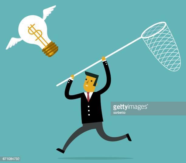 Businessman catch flying idea bulb