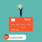 Businessman catching a star on top of a credit card