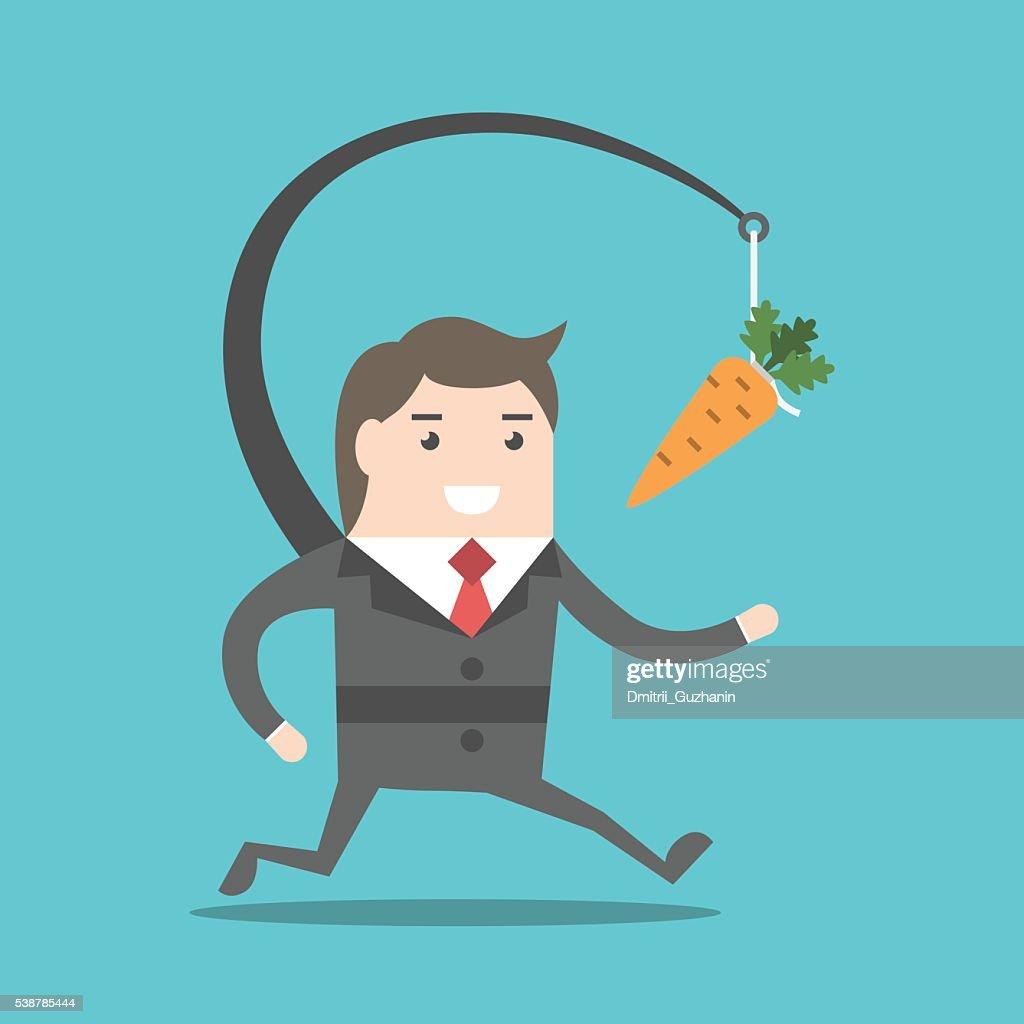 Businessman chasing carrot