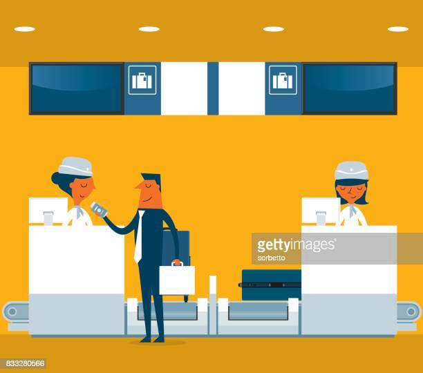 Businessman checking in counter airport