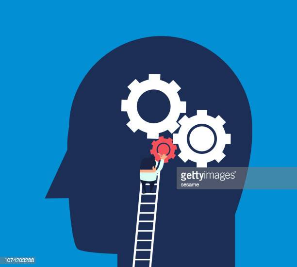 Businessman climbs the ladder to install the gear to the brain