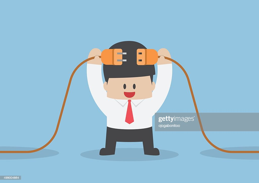 Businessman connecting a electric plug