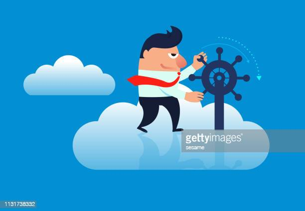 Businessman controls the direction of the rudder in the clouds