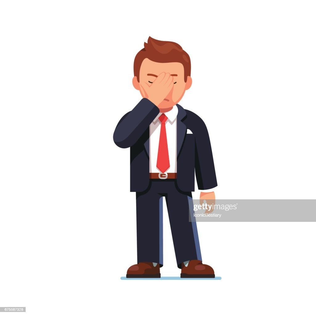 Businessman covering eyes showing facepalm gesture