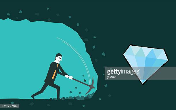 Businessman digging to find diamond