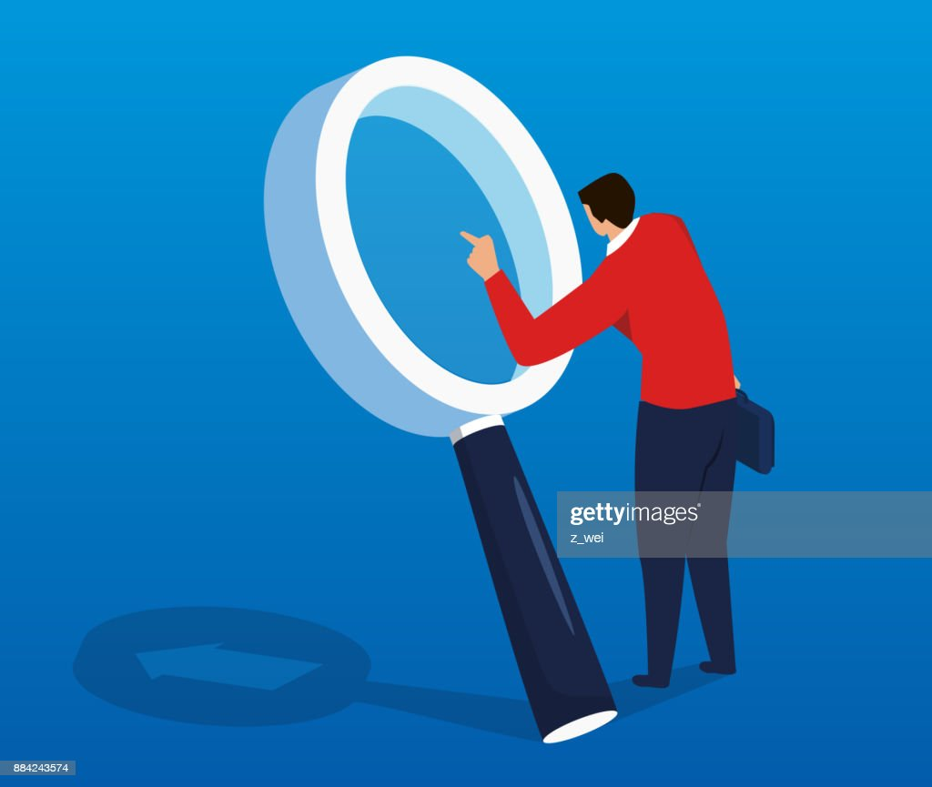 Businessman doing research with a magnifying glass