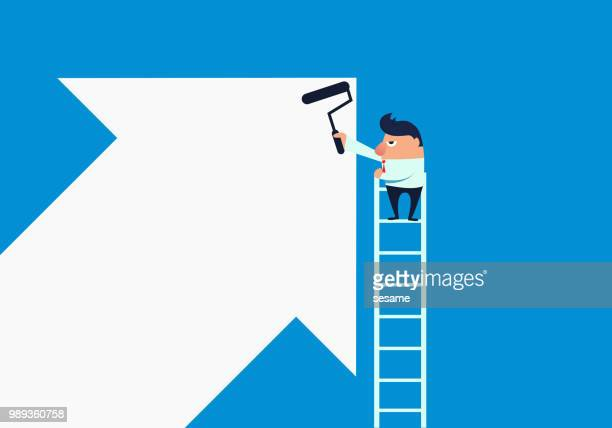Businessman draws an upward arrow