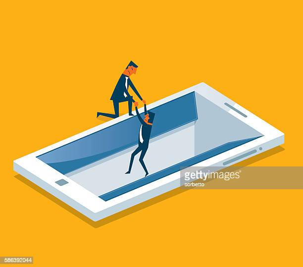 Businessman drowning in a digital tablet