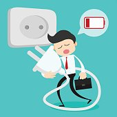 Businessman feeling tired and need to charging battery.worker refresh concept