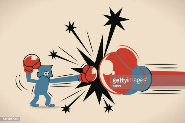 Businessman (boxer, man) fighting against big boxing glove. punching (hitting). David and Goliath Concept
